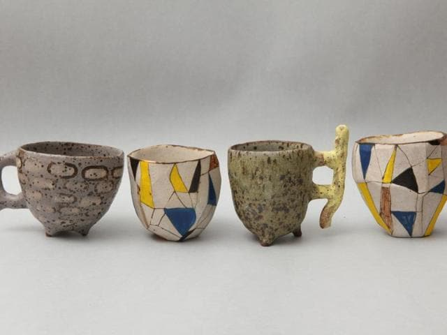 Artists have transformed the cups displayed at the exhibition into pieces of fine art.