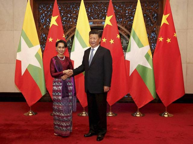 Myanmar's State Counsellor Aung San Suu Kyi shakes hands with Chinese President Xi Jinping before their meeting at Diaoyutai State Guesthouse in Beijing on Friday.
