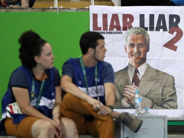 A poster showing a likeness of Ryan Lochte of USA is seen at the athletics stadium in Rio on Thursday.