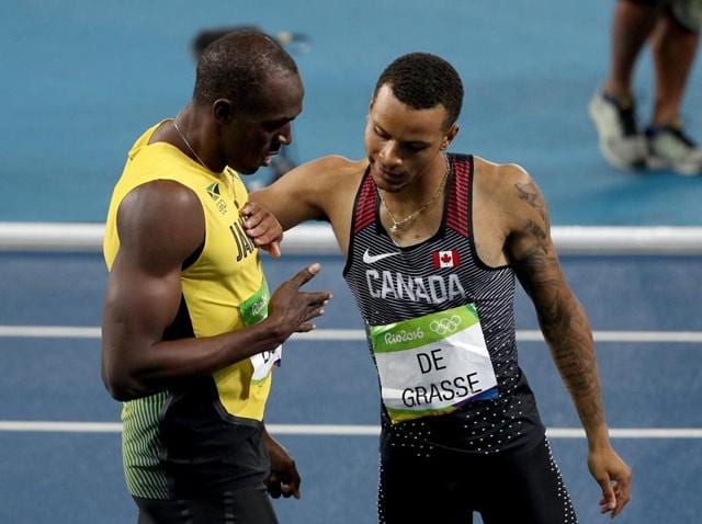 Jamaica's Usain Bolt, center, and Canada's Andre De Grasse, left, compete in a men's 200-meter semifinal during the athletics competitions of the 2016 Summer Olympics at the Olympic stadium in Rio de Janeiro on Wednesday