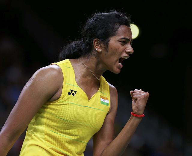 Sindhu celebrates winning a point with a fist-pump. (REUTERS)
