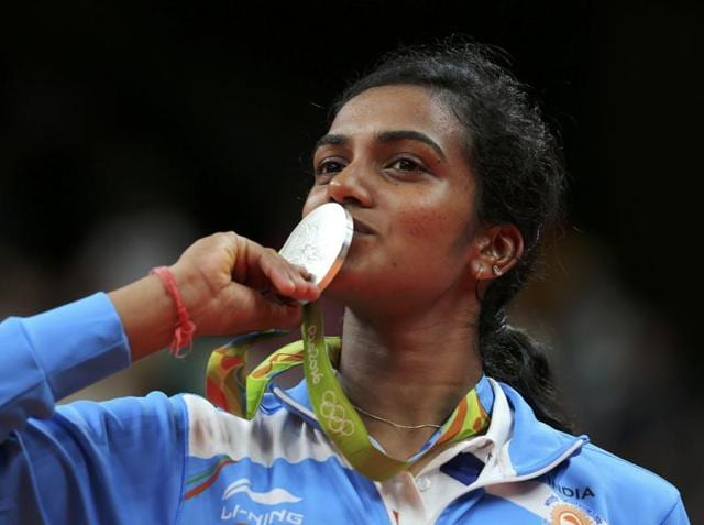 Silver medallist PV Sindhu of India poses kissing her medal.