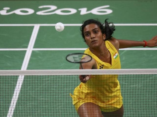 PV Sindhu acknowledges the crowd after winning the women's singles semifinal against Japan's Nozomi Okuhara on Thursday.