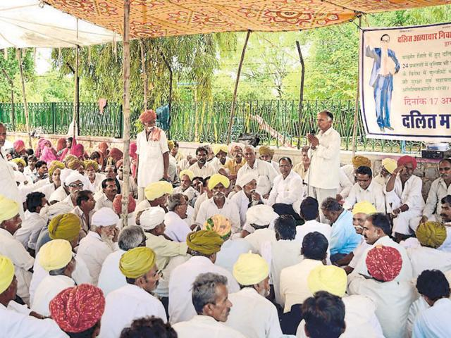 Dalits stage a dharna outside Barmer collector's office on Friday to protest against the spurt in atrocities on the members of the community over last few months.
