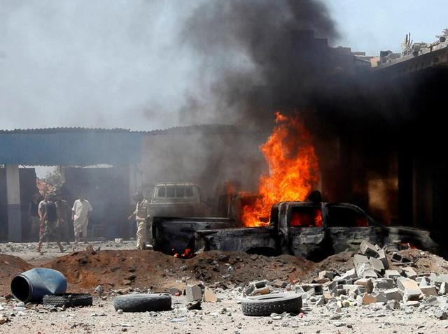A view of the scene following a car bomb attack in al-Gharbiat in Sirte.