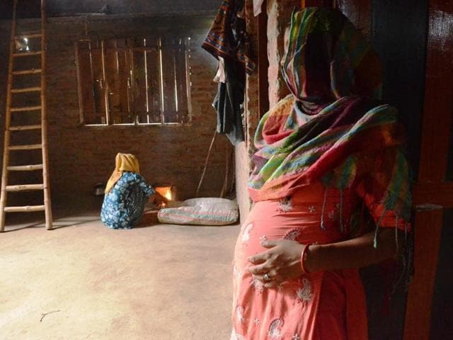 The teen rape survivor (right) at her house in Bareilly.