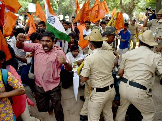Police stop ABVP activists who were trying to enter the Amnesty International India office during a protest against the NGO in Bengaluru.