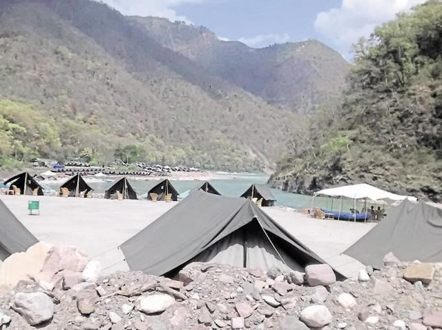 In this file photo, tents can be seen along the banks of Ganges near Rishikesh. The ban on plastic to free the river of the menace, remains on paper as authorities have shown little interest in cracking the whip on offenders.