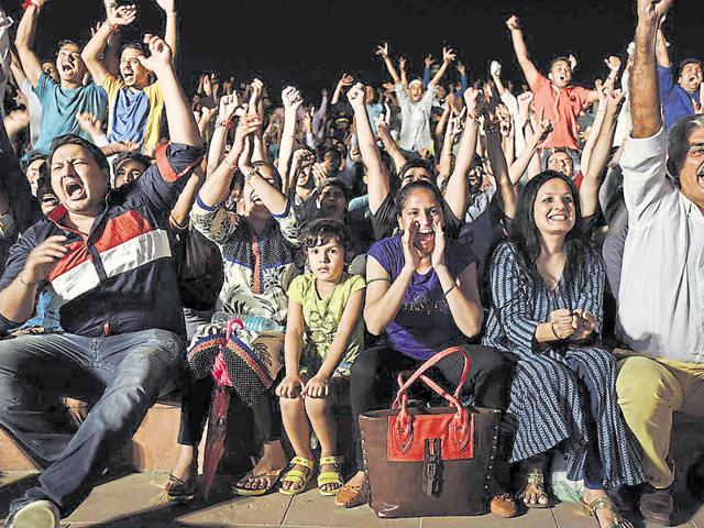 Supporters of badminton star PV Sindhu cheer at central Park Connaught Place in New Delhi on Friday.