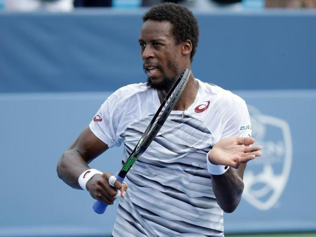 Gael Monfils of France hits a return in his match against Pablo Carreno Busta.
