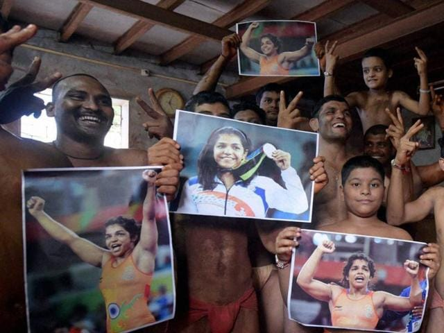 Wrestlers at Laksminarayan Vyayamshala, a traditional sport training centre, in Mumbai celebrate wrestler Sakshi Malik's bronze medal win at Rio Olympics.
