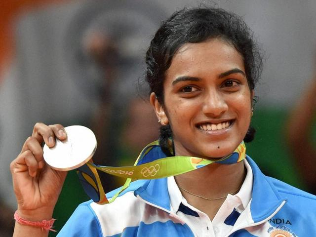India's Pusarla V Sindhu kisses her silver medal after her match with Spain's Carolina Marin.