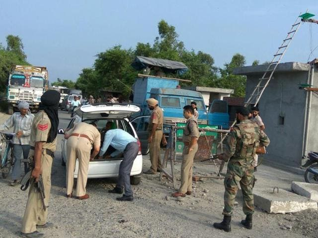 Checking of vehicles going on in Pathankot on Saturday.