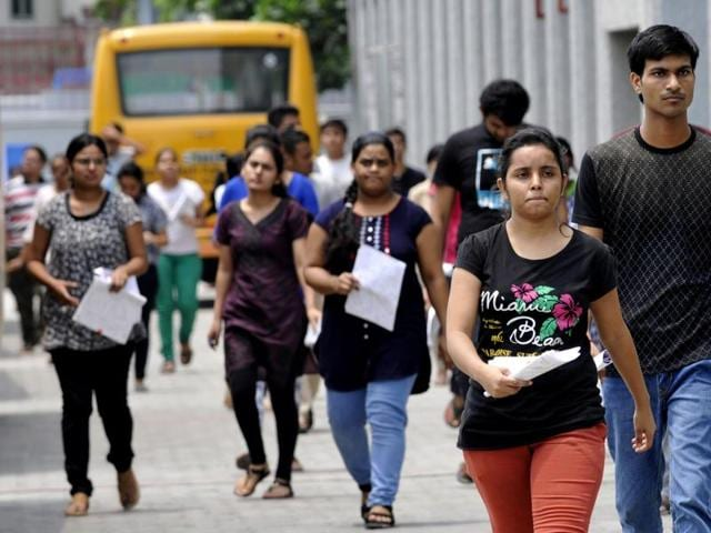 Applicants stepping out of the examination centre in Noida after appearing for NEET 2  exam on Sunday, July 24, 2016.