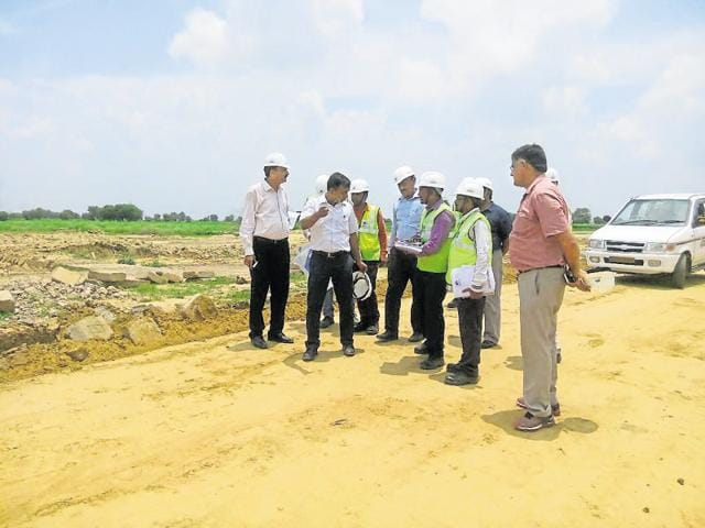 Chief executive officer of Greater Noida authority, Deepak Agarwal, inspects the DMIC site in July.