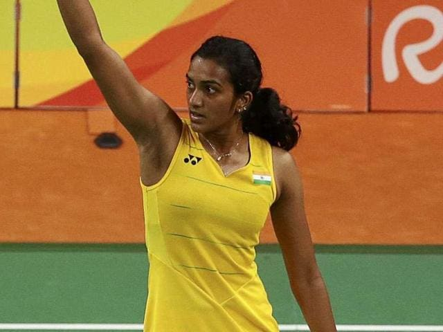 Silver medallist PV Sindhu of India poses with an Indian national flag.