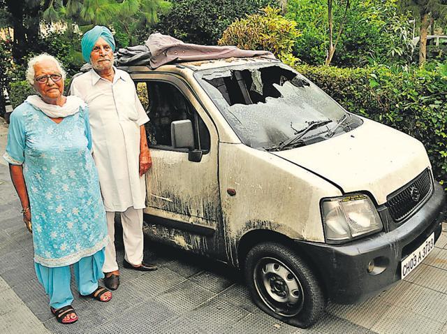 Car owner Gurdip kaur with her husband Jaswant Singh.