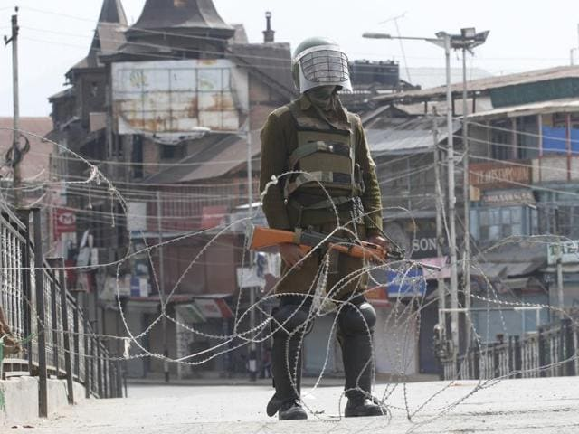 File photo of paramilitary soldier standing  guard during a restriction in Lal chowk area of Srinagar on April 15,  2016.