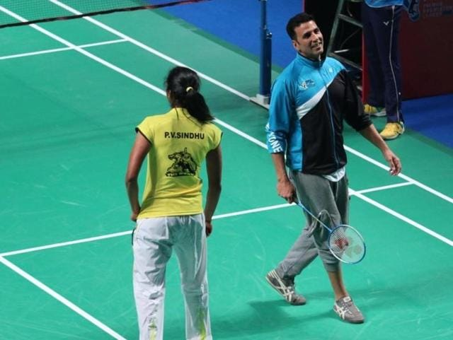 Akshay Kumar and P V Sindhu during a PBL exhibition match in New Delhi on Jan 17, 2016.