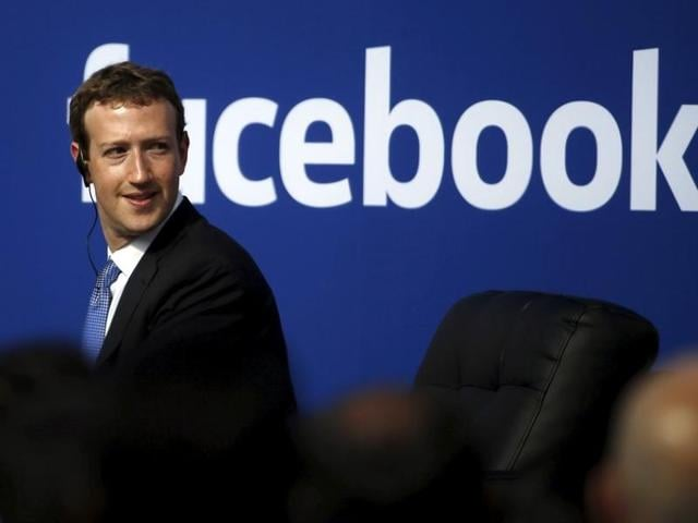 Facebook CEO Mark Zuckerberg is seen on stage during a town hall at Facebook's headquarters in Menlo Park.