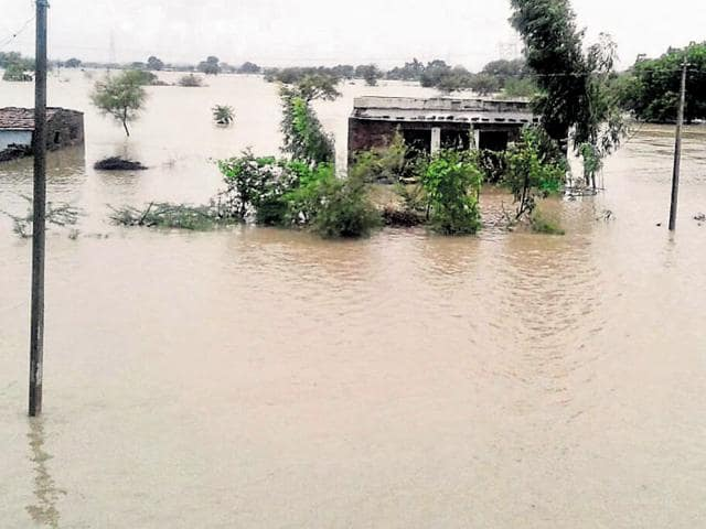 An Air Force chopper rescues people from flood-hit Baran district.