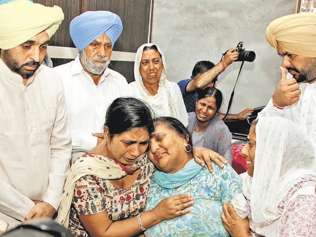 Aam Aadmi Party MP Bhagwant Mann at the house of Hardev Singh, who was crushed to death along with his son Manjit Singh on Thursday, at Baddowal village in Ludhiana on Friday.