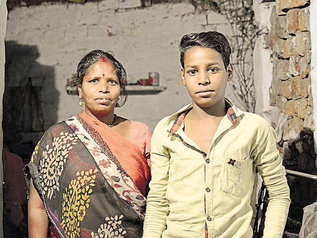Kaushal Shakya (here with his mother) caught Rahul Gandhi's eye as a newspaper seller in April 2013.