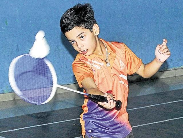A player taking a shot during the Badminton Championship at Guru Nanak Stadium in Ludhiana on Friday.