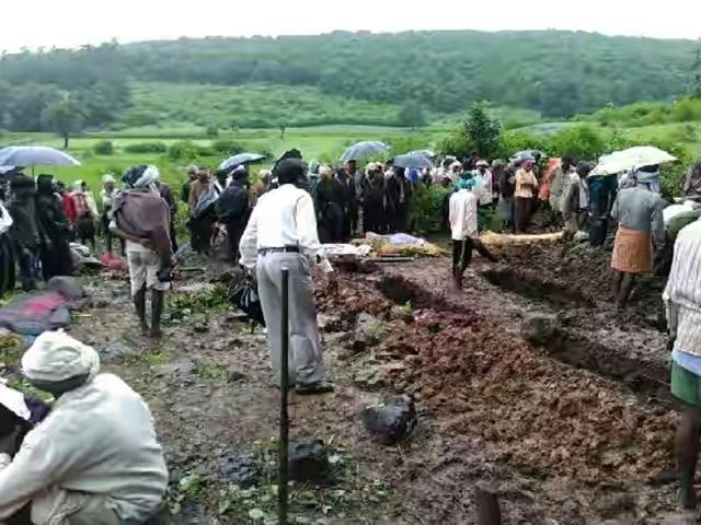 Villagers bury the accident victims at Devhara village in Jabalpur district on Friday.