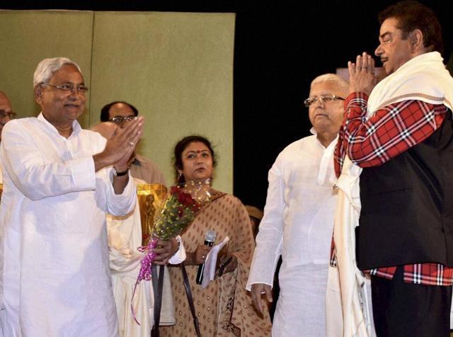 BJP MP Shatrughan greets Bihar chief minister Nitish Kumar and RJD chief Lalu Prasad at a function in Patna.