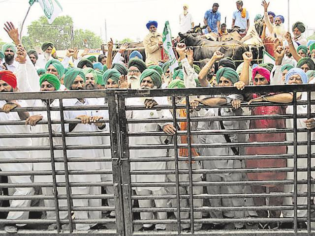 Members of the Bharti Kisan Union holding a protest outside the district administrative complex in Muktsar on Friday.