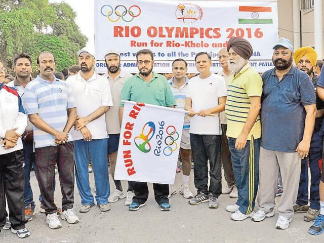 Additional deputy commissioner Mohinderpal Singh flagging off marathon run for Rio Olympics 2016 at polo ground in Patiala on Friday.