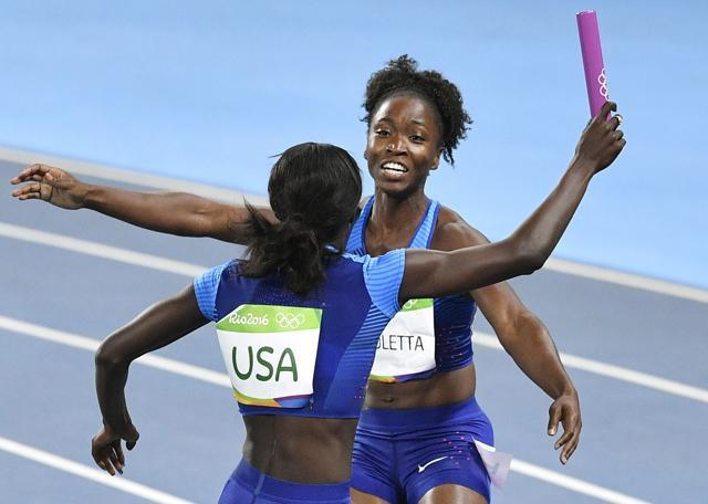 United States's Tianna Bartoletta (right) and Tori Bowie celebrate winning the gold medal after the women's 4x100-metre relay. (AP Photo)