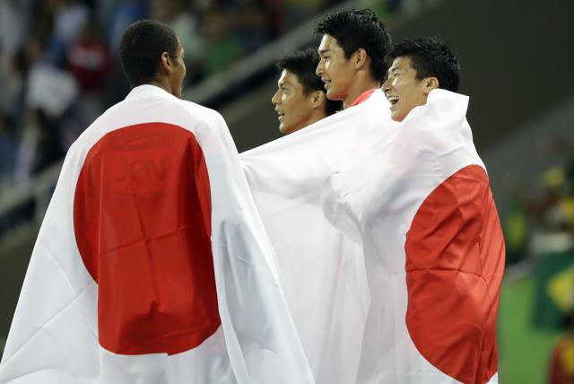 The Japan team celebrate winning the silver medal in the men's 4x100-metre relay final . (AP Photo)