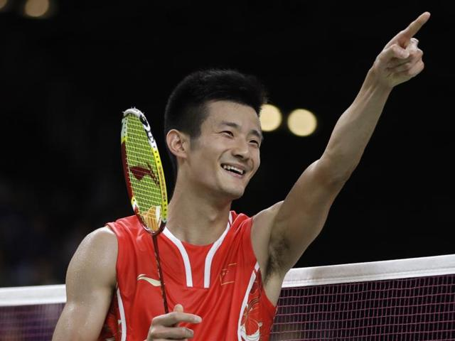 Gold medallist Chen Long (CHN) of China poses on the podium with silver medallist Chong Wei Lee (MAS).