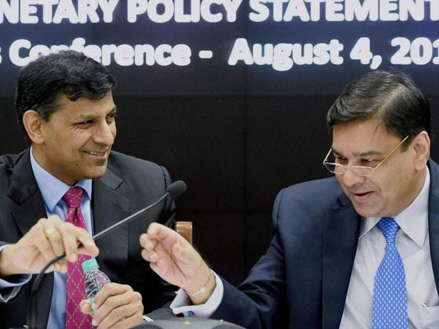 File photo of current Reserve Bank of India governor Raghuram Rajan with Urjit Patel, who will replace him as the central bank's chief.