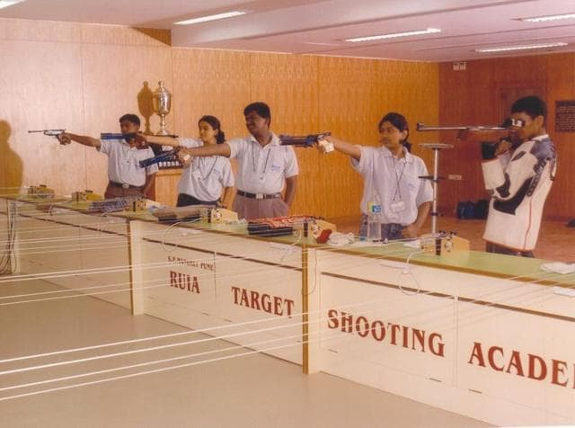 Students try their hand at  Ruia College's shooting range.