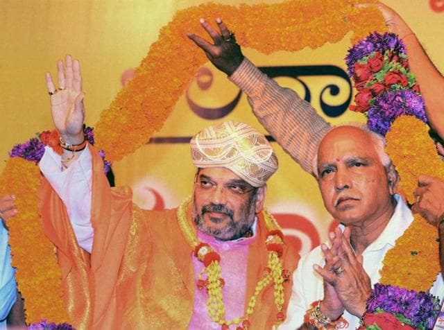 BJP national president Amit Shah and Karnataka state president BS Yeddyurappa at party workers' convention in Mangaluru on Sunday.