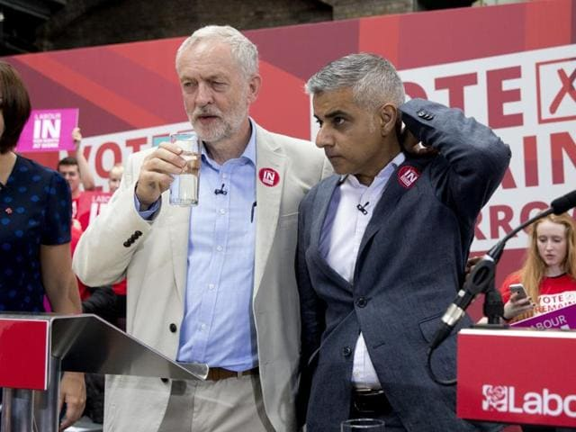 Labour Party leader Jeremy Corbyn (left) speaks with London Mayor Sadiq Khan as they attend a final rally in favour of UK remaining in the EU in central London on June 22.