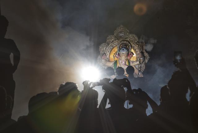 A Ganpati idol being carried to Rangari Badak Chawl from a Chinchpokli workshop in Mumbai, on Saturday.,