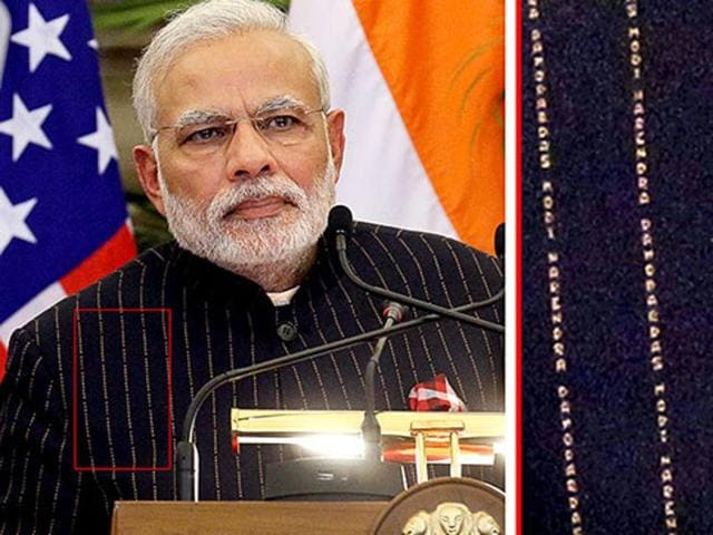 A close view of PM Narendra Modi's pinstripe suit.