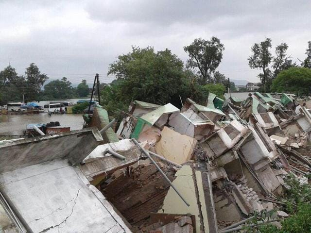A three storied building collapsed in Maihar town of Satna. At least two persons were buried alive five others were hurt severely. A few others are still feared trapped in the debris....ht photo