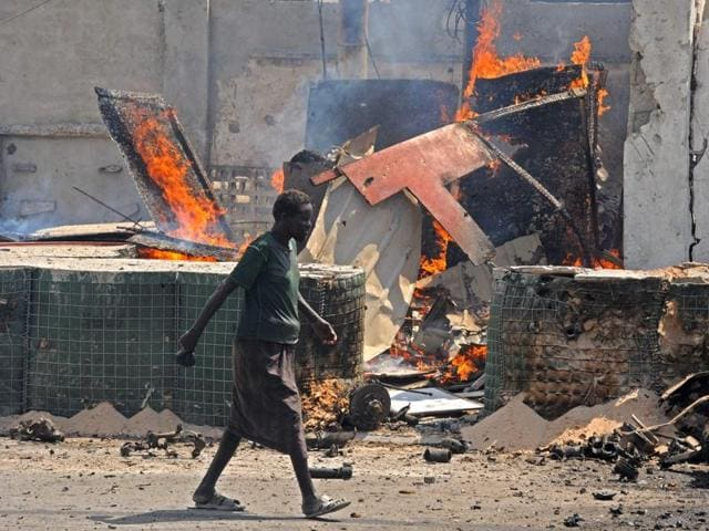 More than 20 people were killed on Sunday when suicide bombers from the militant al Shabaab group detonated two car bombs in Somalia's Puntland region.