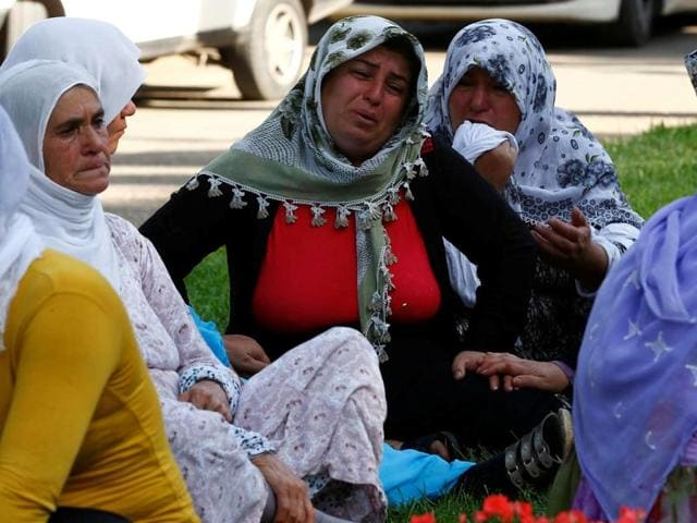 Women mourn as they wait in front of a hospital morgue in the Turkish city of Gaziantep, after a suspected bomber targeted a wedding celebration in the city, Turkey, August 21, 2016.