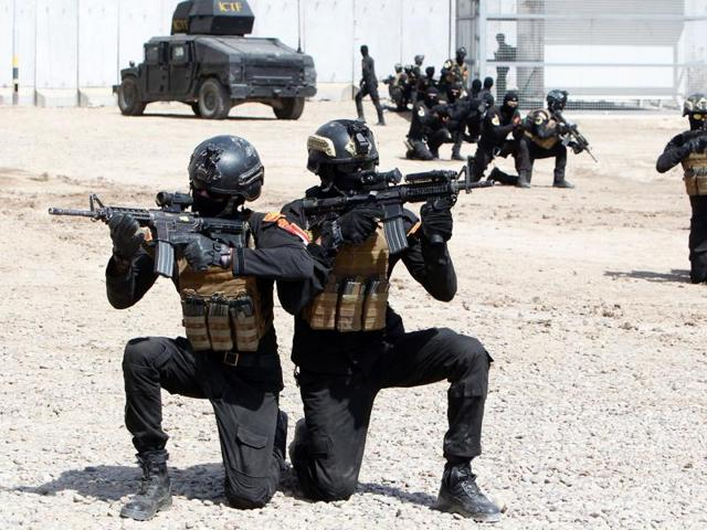 File photo of members of the special forces of the Iraqi counter-terrorism forces during a training in Baghdad . Iraq on August 21, 2016,  hanged 36 men convicted for a 2014 massacre of hundreds of military recrutits.
