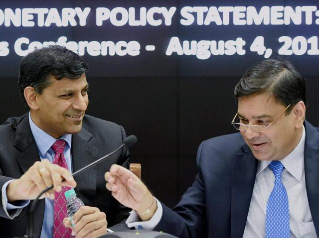 File photo of  Reserve Bank of India governor Raghuram Rajan with Urjit Patel, who will replace him as the central bank's chief in September.