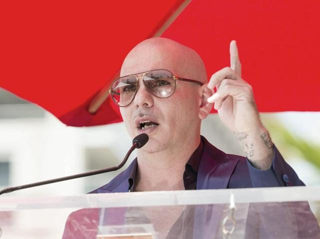 Pitbull's 10th studio album will feature an array of big names including Jennifer Lopez and Enrique Iglesias.