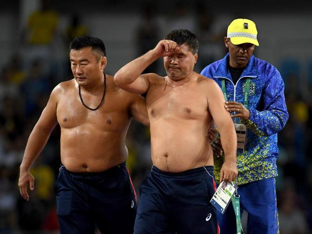 Two Mongolian coaches stripped their clothes off after wrestler Ganzorigiin Mandakhnaran lost the match.