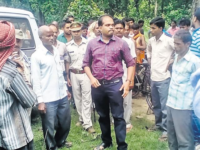 Divisional forest officer (South Kheri) Sanjay Biswal speaks with villagers in Chhedipur village after a man was killed in a suspected tiger attack on Saturday