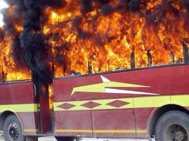 The bus torched by people near Baddowal on Ferozepur road in Ludhiana on Thursday.